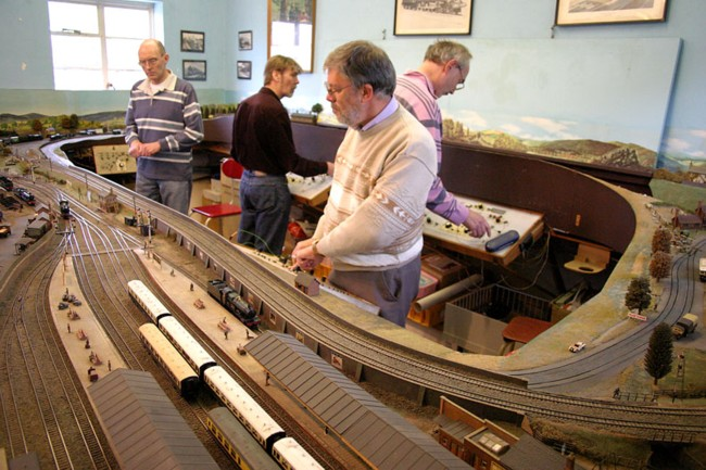 Photo of club members operating the Cheltenham Spa layout in the clubhouse
